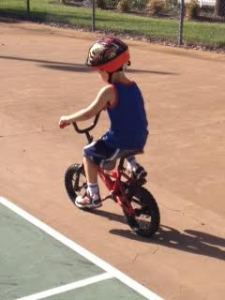 Josh learning to ride without training wheels